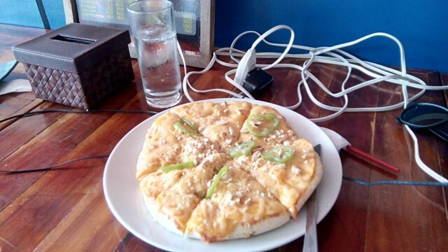 A must-try pizza variety by The Pitstop-- the mango pizza!