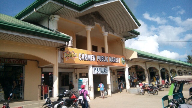 Public market in Carmen. You will only reach the public market in Carmen if you take the bus passing Tubigon. Otherwise, Chocolate Hills Complex is about 3 kilometers away from the public market. To save money and time, make sure to ride a bus passing the Loboc town.