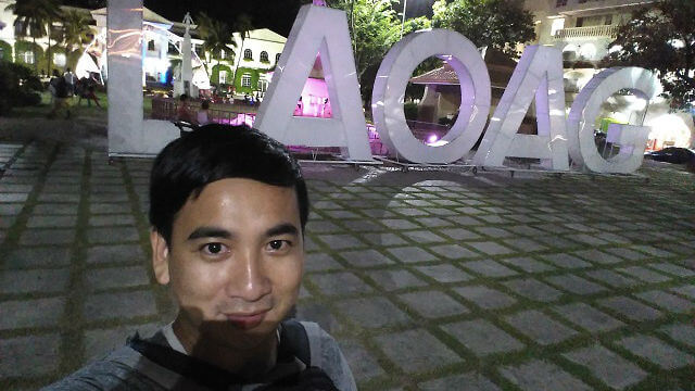 "A selfie taken at the Aurora Park with a big ""LAOAG"" signage in the background."