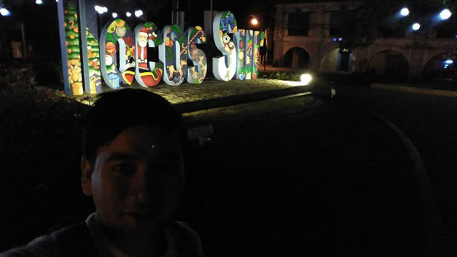 "Selfie at Plaza Salcedo with big ""Ilocos Sur"" in the background."