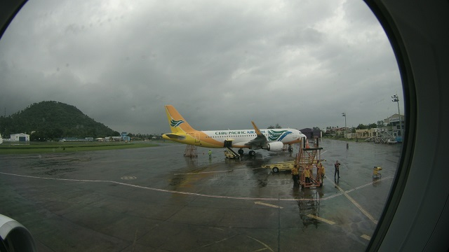 A Cebu Pacific Air airbus at the Legazpi International Airport. A windy and cloudy day made the Mayon Volcano hidden in the clouds.