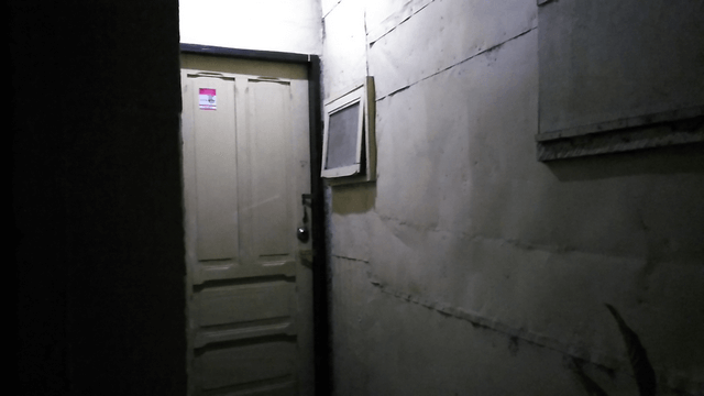 Door of the transient house / apartment with outside light turned on. It is dark in this area when the light is not on.