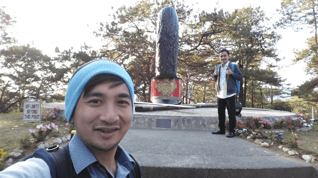 My friend and I posing at the Shako Monument inside Philippine Military Academy (PMA) compound.